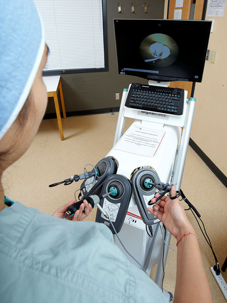 Surgical resident practices basic laparoscopic procedure skills using LapSim®, a virtual training system.