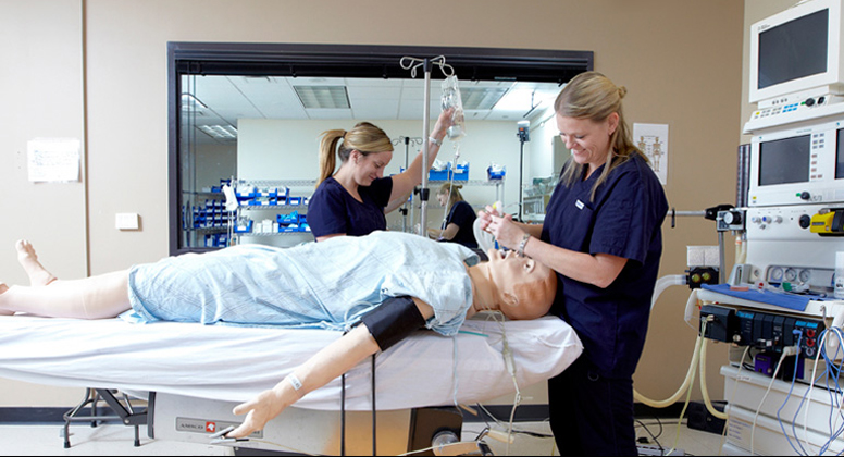 Simulation lab assistants setting up for a simulation event