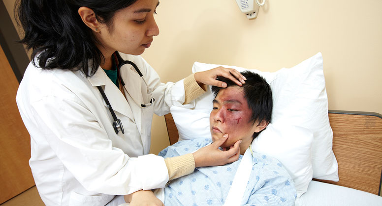 Moulage is applied on standardized patient's face to simulate facial injury
